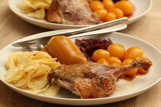 Roast duck with potatoes and red cabbage