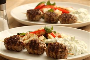 Greek meatballs with tzatziki and tomato salad