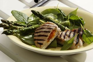 Apricot-stuffed chops and spinach with asparagus