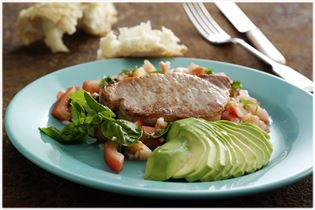 Pork chops with avocado and tomato
