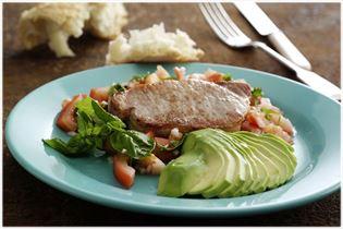 Pork chops with avocado and tomato