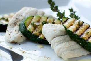 Steamed plaice fillets with grilled courgettes