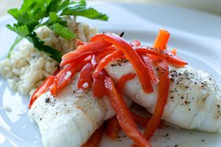 Steamed fish roulades with garlic cheese