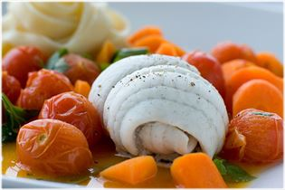 Steamed plaice with carrots in orange juice