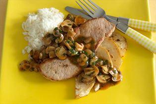 Pork schnitzels with fried celeriac and mushrooms