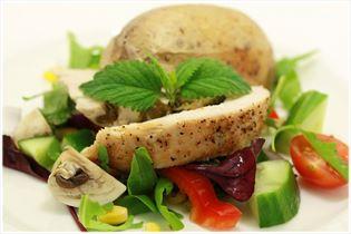Lemony turkey breast with salad and baked potatoes