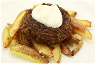 Burgers and fries with garlic dip