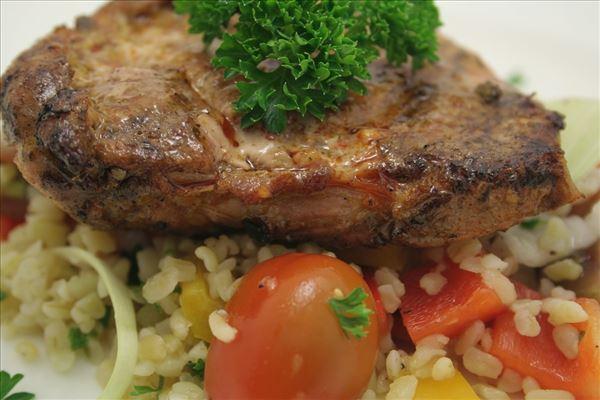 Pork schnitzel with bulgur salad and naan bread